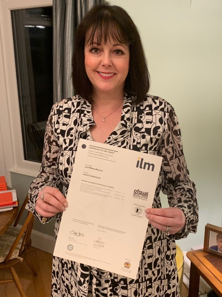 Lynn Morrison of People Puzzles looking rightly pleased with her certificate!